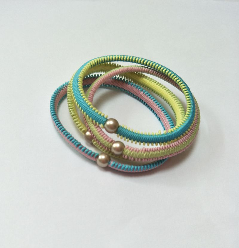 Handmade braided bangle with bead decoration